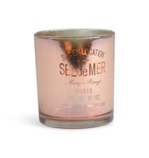 Ljuslykta i glas med text 'Sel de Mer'